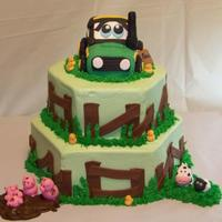 Tractor Cake buttercream hexagons with RKT tractor covered in fondant, farm fence and animals.