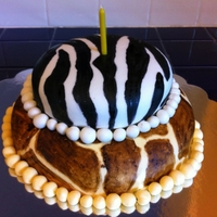 Zebra And Giraffe Cake Cake covered in homemade MMF. Patterns were painted using Wilton gel colors.