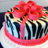 Zebra Cake With Hot Pink Ribbons And Bow Cake is marble (chocolate fudge and vanilla) using Duncan Hines cake mix; icing used is chocolate ganache (2 parts semi-sweet chocolate...