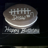 Football Cake Carved cake with fondant. Laces are also fondant.