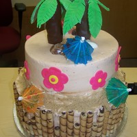 Tropical Themed Birthday Cake RKT and fondant palm trees and flowers. Bamboo look made with chocolate creme cookies. Sand is light brown sugar.