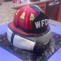 Fire Helmet And Hose I am a fire inspector for the local fire department and made this cake for our annual fundraiser cake decorating contest and auction....