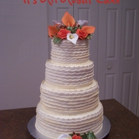 Wedding Cake In Fall Colors Wedding cake with ruffles and handmade sugar flowers.
