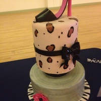 Girly Birthday Cake gumpaste shoe, bow & flower. Painted fondant leopard print and painted silver base cake. Board is also covered in fondant and painted...