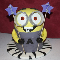 My Version Of A Minion My 17 year old daughter requested that I make this for her birthday! It was red velvet cake with chocolate chip cookie dough filling...