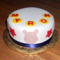 Whinnie The Pooh 6 in, cake, covered in white SI fondant, with fondant decorations.