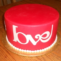 Red Love   Cake I made for the local county fair. Caek dummy covered in red SI fondant with gumpaste decorations cut with cricut.