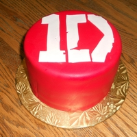 1 Direction 6 in. chcoolate cake with lyers of bavarian cream and strawberry filling, iced with vanilla BC, covered in SI fondant.