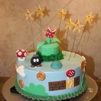 Super Mario Brothers! Iced in SMBC and most of the details are made of fondant. This cake certainly brought back lots of fond childhood memories! ;-)