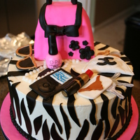 "Purse Cake 10"" zebra print cake topped with a hot pink purse with gumpaste and fondant purse ""contents""."