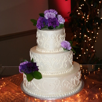 Ivory Wedding Cake This was my first wedding cake! I stressed over it for months but it went really smoothly.. whew! Iced in SMBC and I used a pearl lustre...