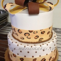 Leopard Pint Cake Hand painted leopard print ribbon cake.