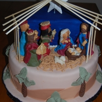 Nativity Scene Yellow Cake with peanutbutter BC filling, covered in fondant. Characters were sculpted from homemade modeling chocolate. Manger is bamboo...