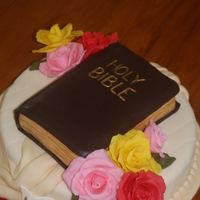 My Mother's Bible Vanilla cake, Bible is cake also. Cover is milk chocolate, roses are white chocolate.