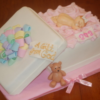 Welcoming Baby Ava Strawberry cake, 'box lid' is also cake. Buttercream filling, covered in fondant. All accents are fondant. Baby is white...