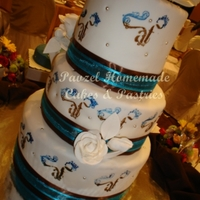 Monogrammed Cake A 3-tiered wedding cake decorated with the couple's monogram similar to that displayed on their wedding invitation.