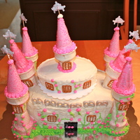 Princess Castle Vanilla cake layers with Vanilla/Almond buttercream. All items are edible. Towers made from ice cream cones coated in melted chocolate....