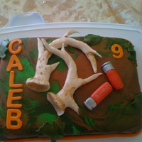 Deer Hunter My nephew is an aspiring hunter so he loved this cake. My camo fondant didn't quite go as planned but turned out okay. The antlers are...