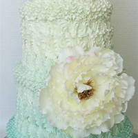 Turquoise Ombre With Peony By Mili The bride and groom's goal was to have a large ombre pattern cake in shades of turquoise with one giant peony flower to the side....