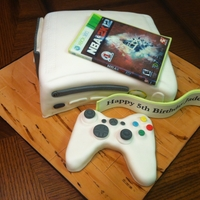 Xbox 360 Xbox 360 Game Console with 2K12 Game made of fondant. Wood floor board made from fondant.