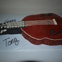 Guitar Cake My first carved cake ever! Vanilla cake w/ raspberry filling.