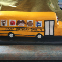 Cartoon School Bus School bus made with chocolate (9x13 cut in 3rds and stacked) for the back and funfetti (9x13 cut in 3rds and stacked) in the front. Carved...