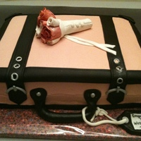 Pink Suitcase Going away cake for a co-worker who was moving to another state and getting re-married. Half sheet cake stacked. Red Velvet cake with white...