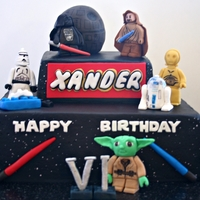 Star Wars Lego Cake 10 inch and 6 inch cakes iced in chocolate buttercream with fondant accents.