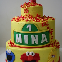 Girly Sesame Street Cake Friend wanted a girly cake for her daughter's first birthday, but her daughter went gaga over sesame street invites....so...flowery...