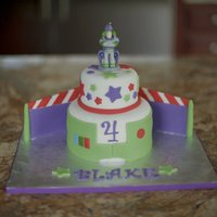 "Buzz Lightyear This cake was inspired by pinkicing's Buzz cake. It's a 6"" and a 4"" with a buzz candle topper. Wings were made..."