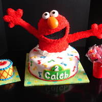 Elmo Cake Elmo is made with RC and covered in BC; eyes and nose are MMF. Cake is Red Velvet cake with cream cheese frosting covered in MMF. The small...