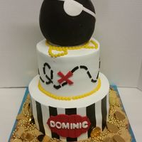 "Pirate Mickey! 7"" 10"" rounds frosted in Pastry Pride. Mickey's head is RKT covered in fondant"
