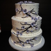 Lavender Blossoms This cake was all iced in Pastry Pride. Flowers are gumpaste