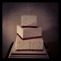 Piped Wedding Cake To Match Invites Bottom Tier Red Velvet Cake With White Chocolate Ganache Middle Tier Vanilla Cake With Milk Chocolate... Piped wedding cake to match invitesBottom tier red velvet cake with white chocolate ganacheMiddle tier vanilla cake with milk chocolate...