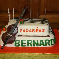 Bernardo's Cello Cake One chocolate cake filled with condensed milk cream and one yellow sponge cake filled with eggs cream, both covered with sugar paste. All...