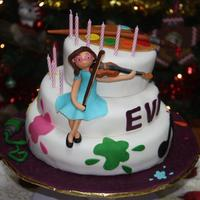 Art And Music Cake Two chocolate cake filled with condensed milk cream and one orange cake filled with coconut cream, both covered with sugar paste. All...