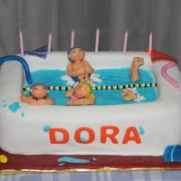 Swimming Pool Cake Yellow sponge cake filled with eggs cream, covered with sugar paste. All edible.
