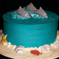 Ocean Cake WASC cake, buttercream icing. Gumpaste dolphins and shells