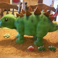 Dino Dinosaur is chocolate cake with oreo creme filling. Decor is gumpaste.