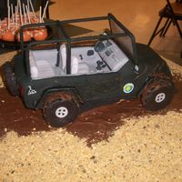 Jeep Orange dreamsicle cake with marshmallow filing. Covered in fondant with gumpaste details