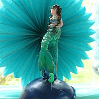 Whale And Mermaid Cake whale cake and mermaid.The whale is red velvet cake, and the mermaid is fondant, everything is done with airbrush
