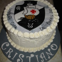 Birthday Cake For A Soccer Fan This cake was made for a Vasco da Gama soccer fan. (A Brazilian soccer team) The symbol was hand painted on fondant. It was a chocolate...