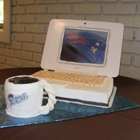 Laptop Laptop computer cake with cup of coffee