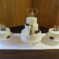 Winter Wedding Cake We made this cake for a couple who were going to blend their family. We were given guidelines (must have winter feel, have brown/pink and...