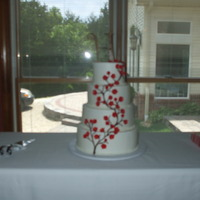 "Red Cherry Blossom 4 tier buttercream with fondant blossoms. ""Kitchen cakes"" and a personal anniversary cake to match."