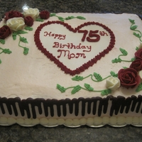 Valentine/birthday Cake Marble cake with buttercream icing and chocolate ganache drizzle on the sides