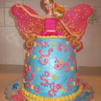 Barbie Cake Real doll in center provided by customer, strawberry cake and blue buttercream