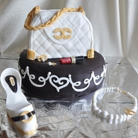 My First Purse Cake Both cakes are red velvet pound with cream cheese buttercream. 12 inch round on bottom covered in chocolate fondant, carved 8x8 cake with...