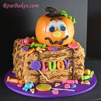 Pumpkin Patch Birthday Cake A Pumpkin Cake on a Hay Bale cake with fondant candy. It's all edible!