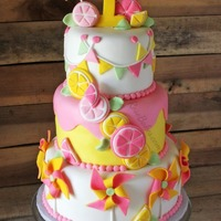Pinwheels & Pink Lemonade Twins 1St Birthday Cake Designed for twins girls 1st birthday. It's 3 tiers of vanilla cake filled with vanilla buttercream and covered with homemade...